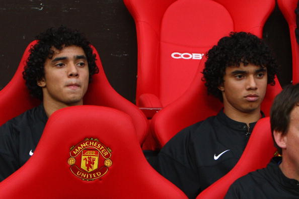 MANCHESTER, UNITED KINGDOM - AUGUST 06:  Rafael Da Silva (L) sits on the bench beside his twin brother and team mate Fabio Da Silva of Manchester United prior to the Pre Season Friendly match between Manchester United and Juventus at Old Trafford on August 6, 2008 in Manchester, England. (Photo by Phil Cole/Getty Images)r